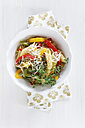 Bowl of pepper pasta with parmesan and thyme on wooden table, close up - EVGF000153