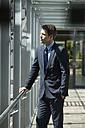 Germany, Hannover, Businessman looking away - KFF000093