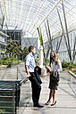Businessman and businesswoman talking at modern office building - KFF000179