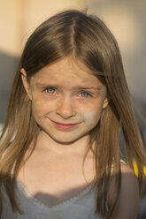 Portrait of smiling girl with coloured chalk in the face - SARF000079