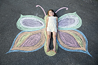 Little girl lying on street painting - SARF000224