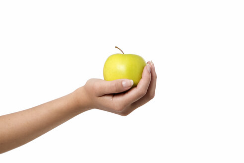 Human holding green apple against white background, close up - GDF000119