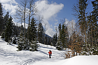 Germany, Mature woman hiking during winter - LB000208