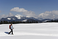 Germany, Mature woman hiking during winter - LB000206