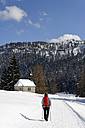 Germany, Mature woman hiking during winter - LB000204