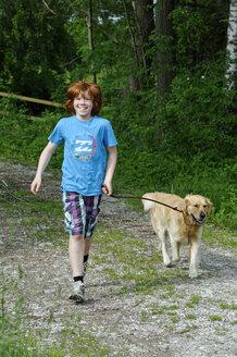 Germany, Bavaria, Boy walking with dog - LB000255