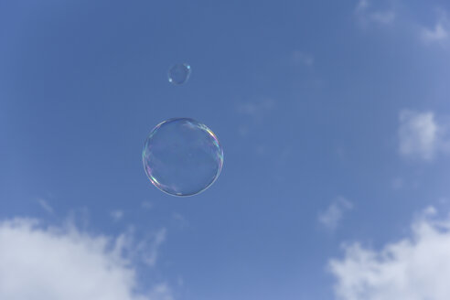 Germany, Bremerhaven, Soap bubble against blue sky - SJF000041
