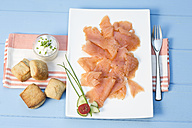 Smoked salmon on plate with napkin, close up - MAEF007131