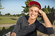 Germany, Young man in park, smiling - GDF000197
