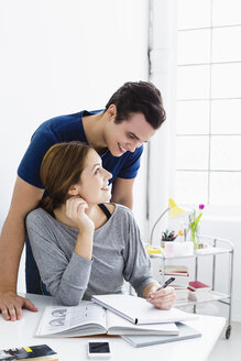 Germany, Bavaria, Munich, Young couple studying, smiling - SPOF000439
