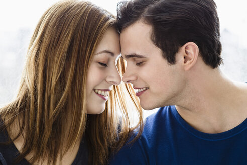 Germany, Bavaria, Munich, Young couple falling in love, smiling - SPOF000451