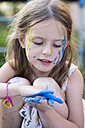 Germany, Bavaria, Girl playing with finger paint, close up - SARF000087