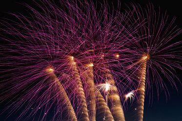 Germany, North Rhine Westphalia, Duesseldorf, Fireworks exploding in sky - KJF000246