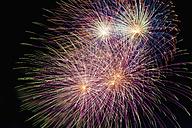 Germany, North Rhine Westphalia, Duesseldorf, Fireworks exploding in sky - KJF000243