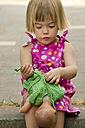 Germany, Baden Wuerttemberg, Girl dresing her doll - LVF000187