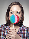 Young woman holding lollipop, close up - STKF000306