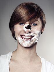Portrait of Young woman face with chocolate marshmallow, close up - STKF000326