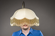 Mid adult man with electric lamp, close up - CA000022