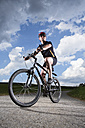 Germany, Bavaria, Mature man riding mountain bike - MAEF007148