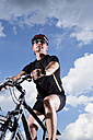 Germany, Bavaria, Mature man riding mountain bike, close up - MAEF007149