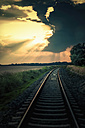 Germany, Saxony, View of railway track at dusk - MJ000340