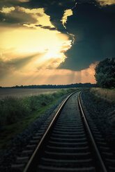 Germany, Saxony, View of railway track at dusk - MJ000340