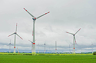 Germany, Mecklenburg-Vorpommern, View of wind turbine in field - MJF000354