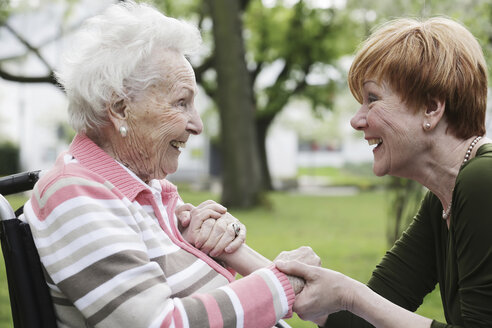 Germany, North Rhine Westphalia, Cologne, Senior woman and mature woman looking at each other, smiling - JAT000224