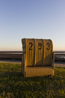 Germany, Lower Saxony, View of hooded beach chair on grass - SJ000047