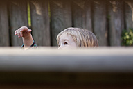 Germany, Kiel, girl behind a wall - JFEF000168