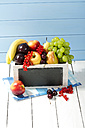 Wooden box with variety of fresh fruits on table, close up - MAEF007206