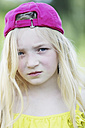 Germany, North Rhine Westphalia, Cologne, Portrait of girl with cap, close up - JATF000236