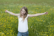 Germany, Bavaria, Girl walking in meadow - CRF002464