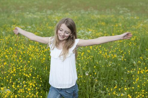 Germany, Bavaria, Girl walking in meadow - CRF002464