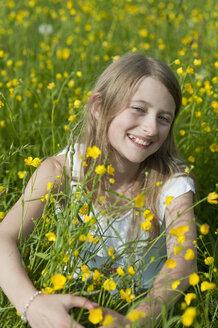 Germany, Bavaria, Portrait of girl smiling - CRF002463