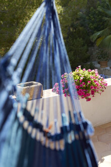 Spain, Hammock with flower pot in background - TKF000158