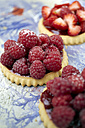 Germany, Raspberry cakes on table, close up - TK000141