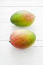 Mangoes on wooden table, close up - CZF000045