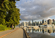 Canada, British Columbia, Vancouver, Cyclist on side walk at Stanley Park - FOF005162