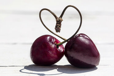 Germany, Bavaria, Heart shaped formed with stems of cherry - SARF000101
