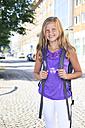 Germany, Portrait of teenage girl holding bag - VTF000015