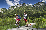 Germany, Bavaria, Chiemgau, Family walking at mountain lake - FF001367