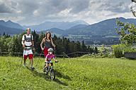 Germany, Bavaria, Chiemgau, family hiking in meadow - FF001365