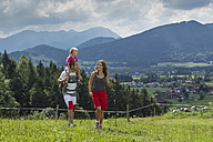 Germany, Bavaria, Chiemgau, family hiking in meadow - FF001370