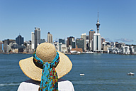 New Zealand, Woman looking at Auckland skyline - GW002391