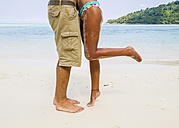 Thailand, Koh Surin island, couple kissing at white sandy beach - MBEF000723