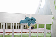 Blue baby shoes hanging to cot - KRP000031
