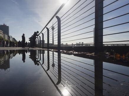 Germany, North Rhine Westphalia, Duesseldorf, People at media harbour with Rhine tower in background - HHE000067