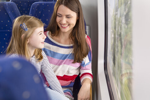 Germany, Brandenburg, Mother with daughter traveling through train - KFF000213