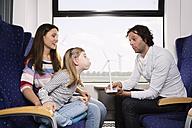 Germany, Brandenburg, Family traveling in train - KFF000216